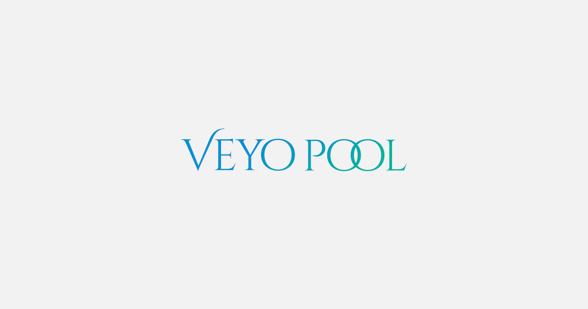 Photograph of people swimming, relaxing and playing at Veyo Pool.