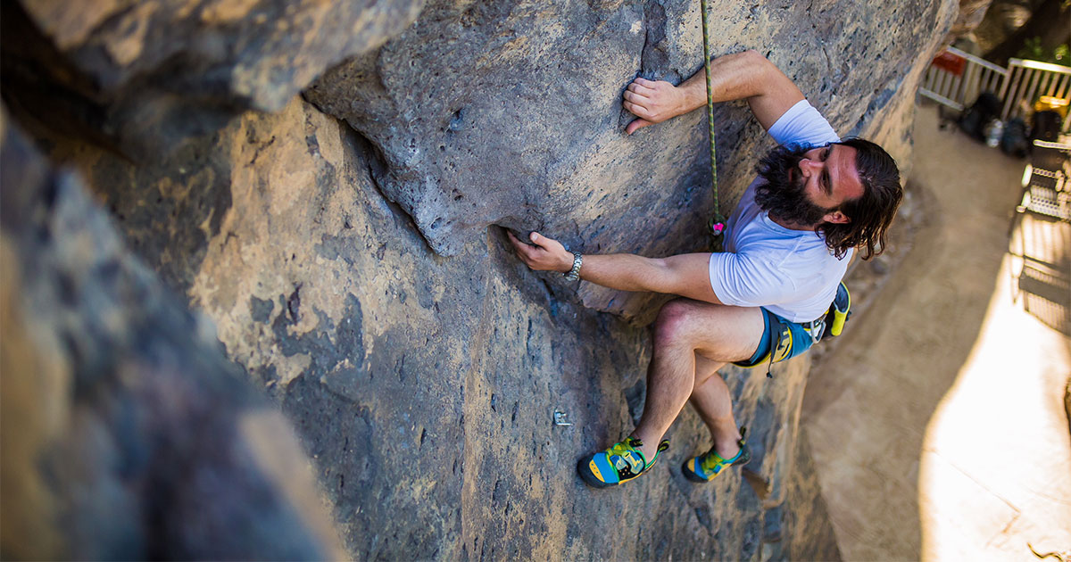 Photography of a bearded man mountain climbing at Veyo Pool.