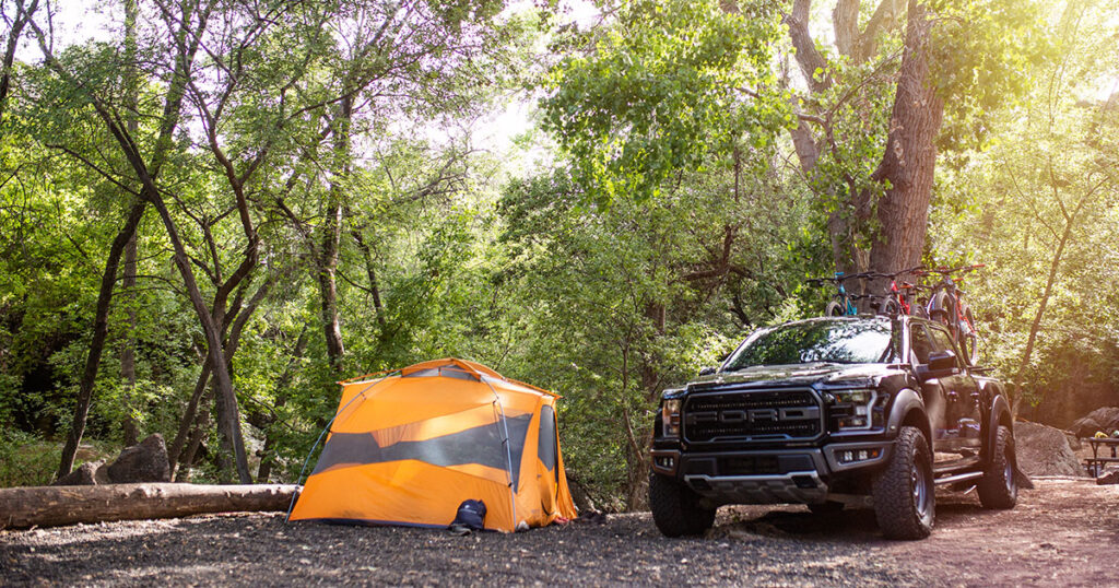 A truck and tent on a premium view campsite.
